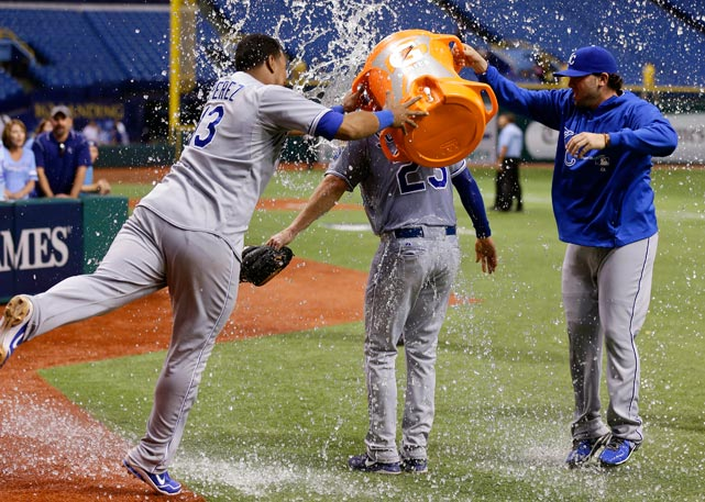 Elliot Johnson is doused by teammates, including Salvador Perez, following the Royals 10-1 win over the Rays. Johnson had a three-run homer in his return to Tampa Bay.