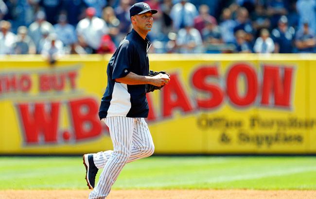 Shortstop Derek Jeter jogs in the Yankee Stadium infield before a June game.