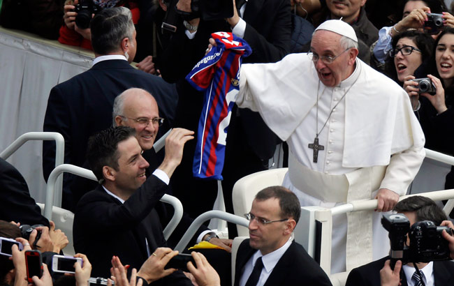 Pope Francis holds a San Lorenzo soccer jersey given to him in March.