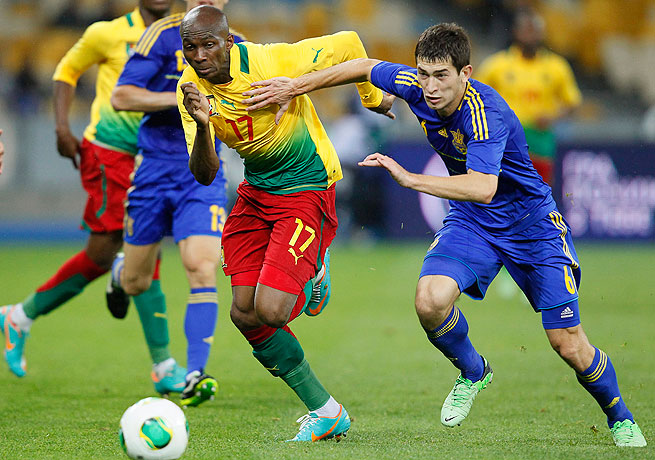 Stephane Mbia (left) and Cameroon face possible disqualification from the 2014 World Cup in Brazil.