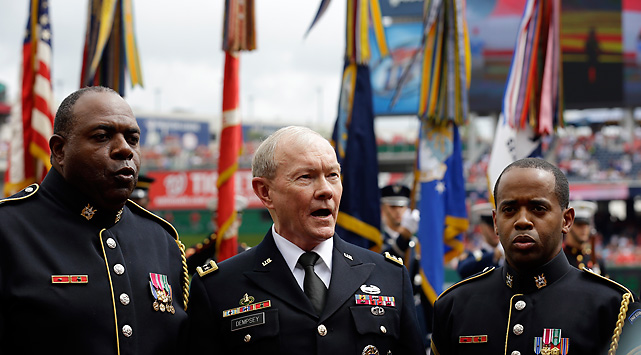 Joint Chiefs Chairman Gen. Martin Dempsey, center, sings the National Anthem with the Army Chorus Quartet Staff including, Sgt. First Class Alvy Powell, left, and Sgt. First Class Colin Eaton before the Brewers played the Nationals on July 4.