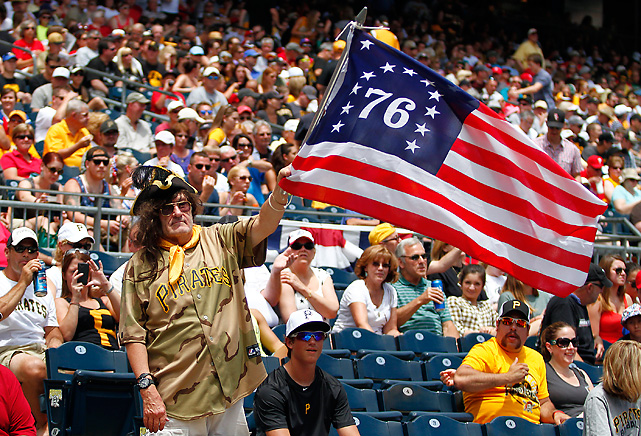 A Pirates' fans commemorates the original colonies with a flag during the Phillies-Pirates game.