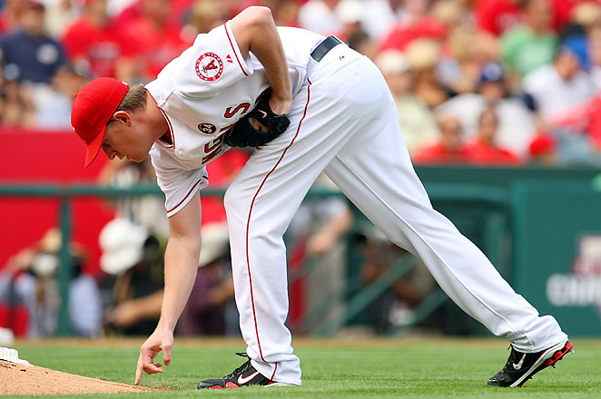 Jered Weaver draws the initials 'NA' for Nick Adenhart onto the mound before each start.