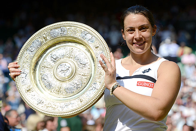 France's Marion Bartoli won the Wimbledon title without dropping a set as the No. 15 seed.