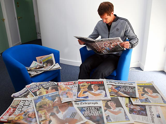 Andy Murray reads through the papers on July 8, the morning after he took home the Wimbledon title.