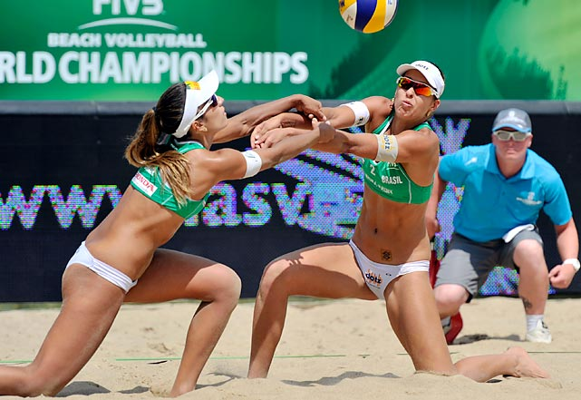 Liliane Maestrini (right) and Barbara Seixas de Freitas of Brazil dig a ball during a semifinal match with China during the FIVB World Championships on July 6 in Poland.