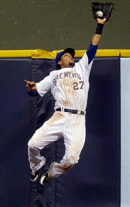 Milwaukee Brewers center fielder Carlos Gomez leaps to catch a fly ball hit by the New York Mets' Marlon Byrd during a 12-5 Mets win on July 5.