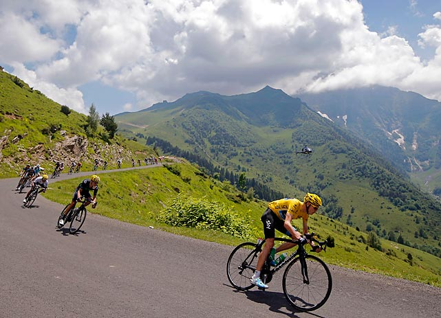 Christopher Froome of Great Britain, wearing the overall leader's yellow jersey, speeds down Val Louron-Azet pass during the ninth stage of the Tour de France.