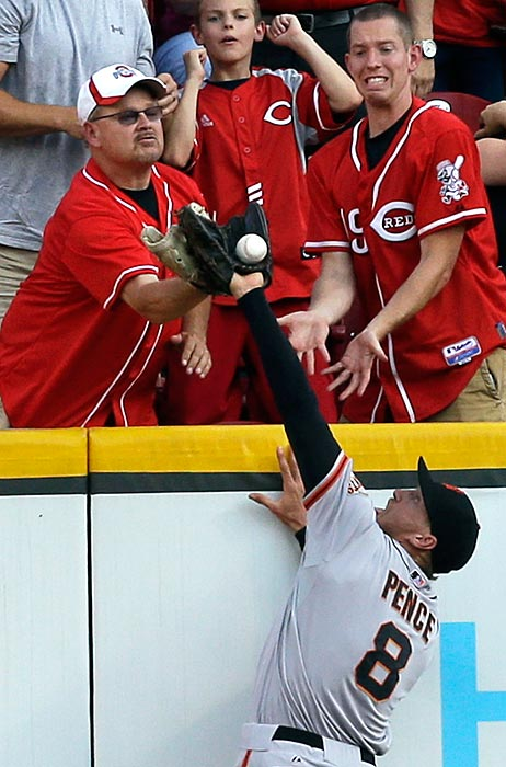 A fan prevents San Francisco Giants right fielder Hunter Pence from catching a ball hit by the Cincinnati Reds' Shin-Soo Choo in a 3-0 Reds win on July 2. Umpires ruled the play a ground rule double.
