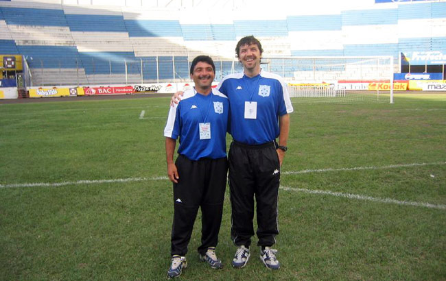 Ian Mork (right) coaches the Belizean soccer team with his former college roommate Rene Montero.