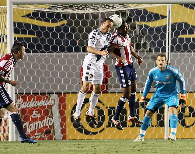 Donovan and James Riley of Chivas USA vie for the ball in the Chivas 18-yard box during an MLS match won by Chivas, 1-0.