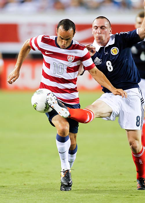 Scottish midfielder Scott Brown steals the ball away from Donovan during the U.S.' 5-1 victory over Scotland in a friendly at Everbank Field in Jacksonville, Fla.
