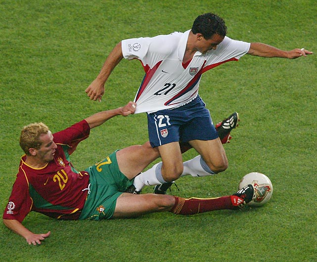 Petit of Portugal holds back Donovan during the second half of the their Group D match played in South Korea. The U.S. won 3-2.