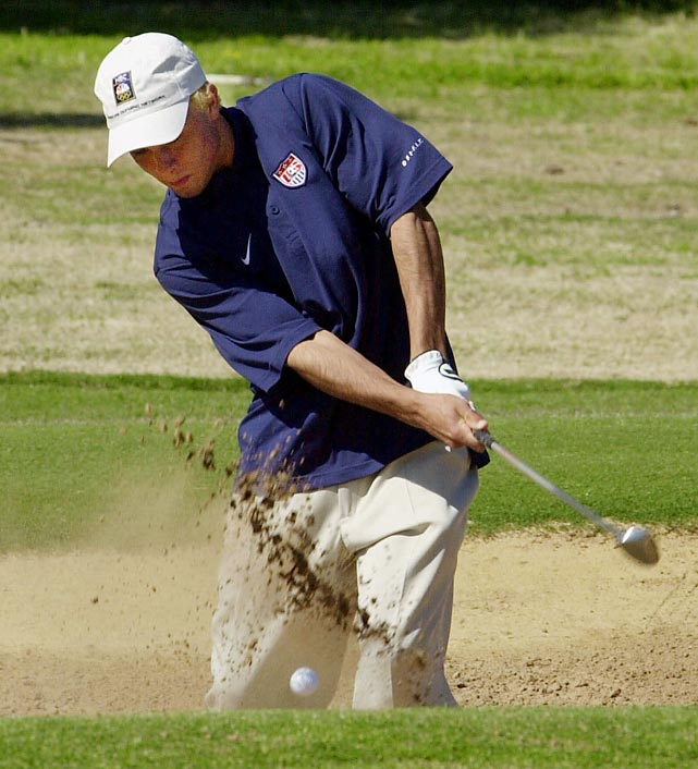 Donovan hits out of a bunker while playing a round of golf in Adelaide, Australia, on an off-day before playing Japan in one of the quarterfinal matches of the Olympics.