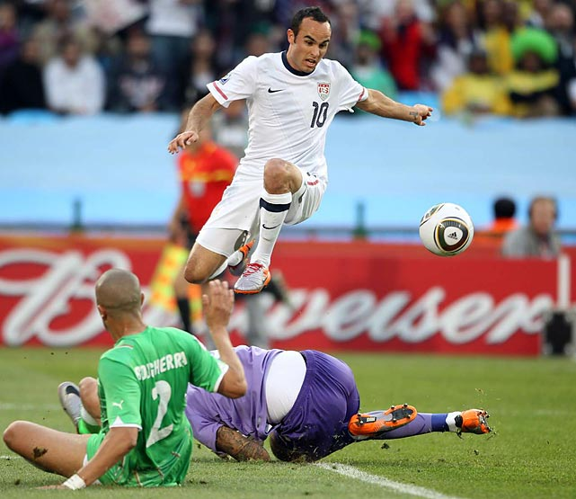 Donovan jumps over the goalkeeper in the U.S. final group stage game against Algeria at the 2010 World Cup in South Africa.