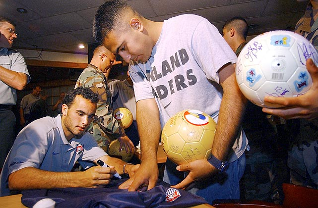 Donovan autographs a USA team jersey for U.S. Army SPC 4 Jesus Medina of Houston during the team's visit to the demilitarized zone in Panmunjom, South Korea. The U.S. soccer squad faced Portugal, South Korea and Poland in the first round of the 2002 FIFA Korea-Japan World Cup.