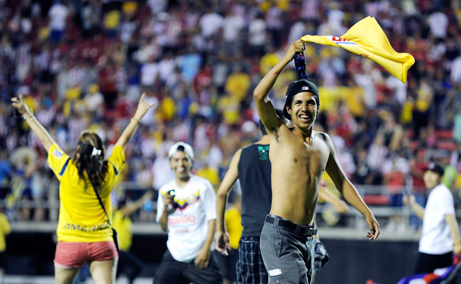 Fans ran on to the field in Las Vegas after Club America's exhibition match vs. Chivas.
