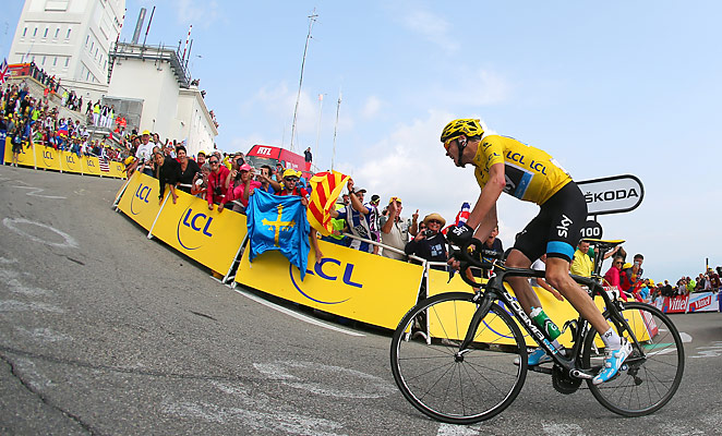 Chris Froome captured stage 15 of the Tour de France with a surge up Mont Ventoux.