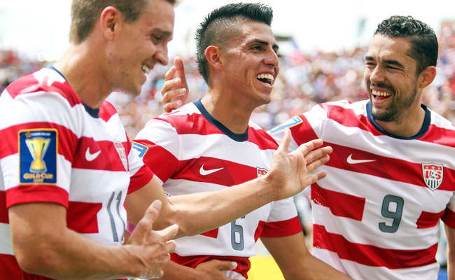 Joe Corona (6) is congratulated by U.S. -- and Club Tijuana -- teammate Hérculez Gómez (9) after scoring against Cuba.