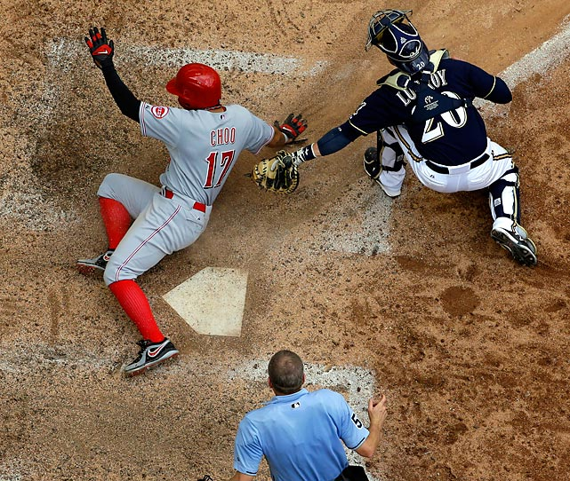 Cincinnati Reds' Shin-Soo Choo avoids the tag of Milwaukee Brewers catcher Jonathan Lucroy tag in a play at the plate on July 10.