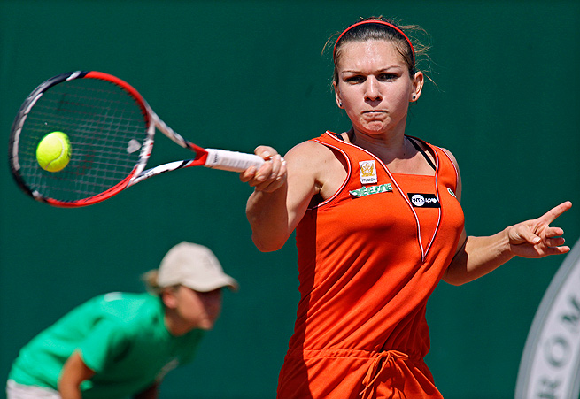 Simona Halep overcame Yvonne Meusburger to win the Budapest Grand Prix, her third title of the year.
