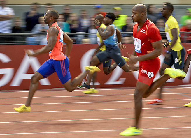 Tyson Gay (left) and Asafa Powell (right) both tested positive for banned substances, as reported Sunday.