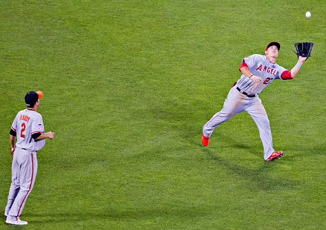 Leftfielder Mike Trout registers an out while shortstop J.J. Hardy looks on.
