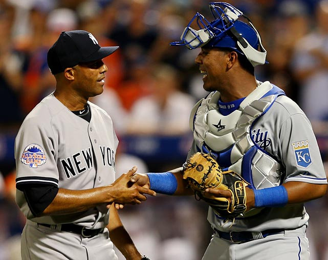 Rivera is congratulated by Salvador Perez of the Kansas City Royals.