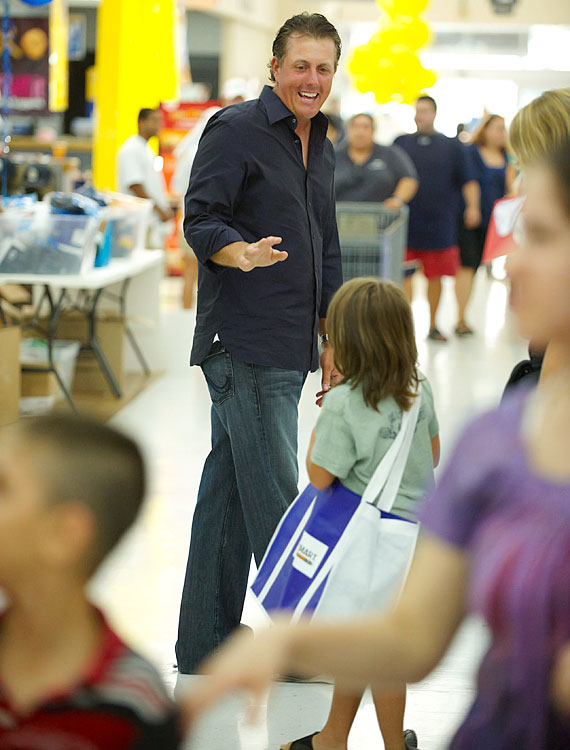 Mickelson talks to a child at Walmart on Murphy Canyon Road in San Diego. The Mickelson Foundation was hosting its 6th annual back-to-school shopping spree for 1,500 underprivileged elementary school students.
