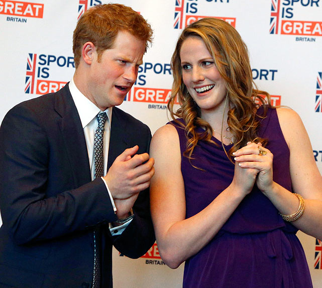 Prince Harry talks with Olympic gold medalist Missy Franklin during a reception at the Sanctuary Golf Course in Sedalia, Colo.