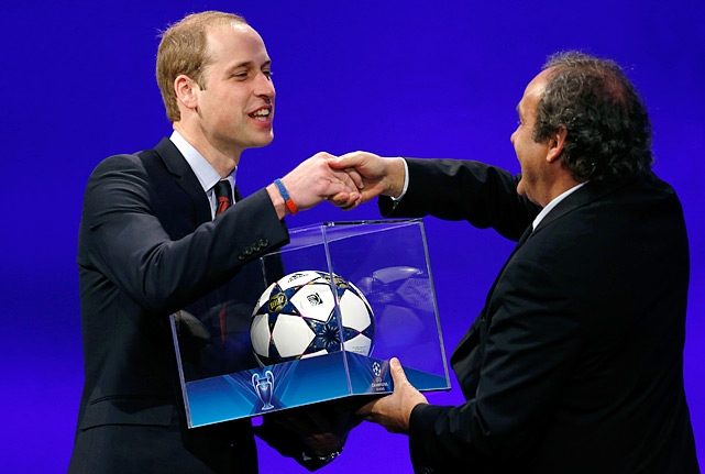 President of the English Football Association Prince William is presented with a football by UEFA President Michel Platini after he addressed the delegates during the 37th Ordinary UEFA Congress in London.
