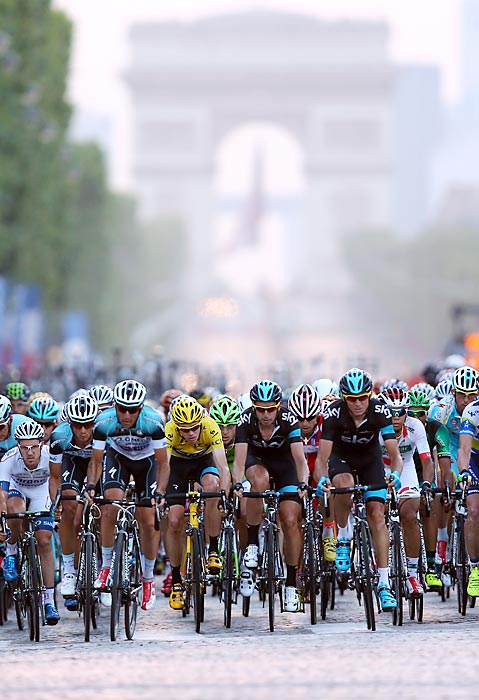 Great Britain's Chris Froome (center) rides during the 21st and final stage of the 2013 Tour de France. Froome held the lead for 13 stages and would eventually secure the victory in the 100th anniversary of the race.