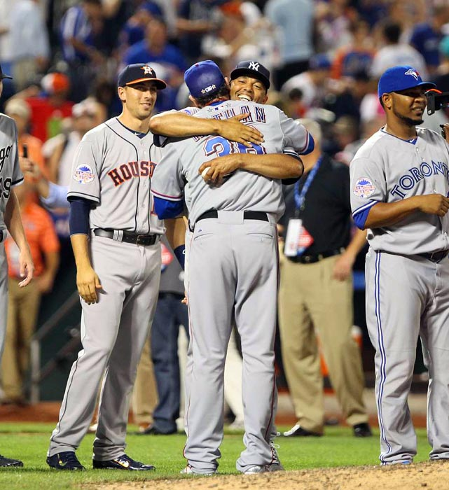 Yankees closer Mariano Rivera hugs Texas Rangers closer Joe Nathan at the 2013 MLB All-Star Game. In what is likely to be Rivera's final All-Star Game, he earned a hold in the eighth inning -- and eventual MVP honors -- as Nathan closed out the win for the American League in the ninth.