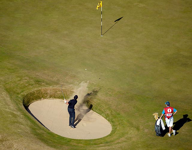 Rory McIlroy of Northern Ireland hits from a bunker on the 10th hole during the second round of the 142nd Open Championship. McIlroy failed to make the cut.
