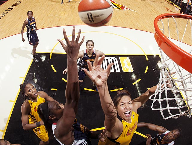 Tina Charles of the Connecticut Sun reaches for a block against Elizabeth Cambage of the Tulsa Shock during a WNBA game. Tulsa won 64-58.