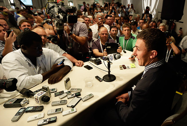 Johnny Manziel's offseason has been full of media swarms, headlines and various other distractions.