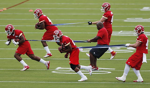 Kansas City Chiefs running backs work out during Chiefs training camp in St. Joseph, Mo.