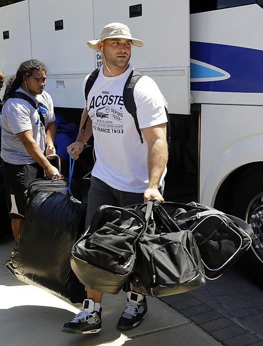 Chicago Bears rookie Kyle Long arrives for training camp in Bourbonnais, Ill.