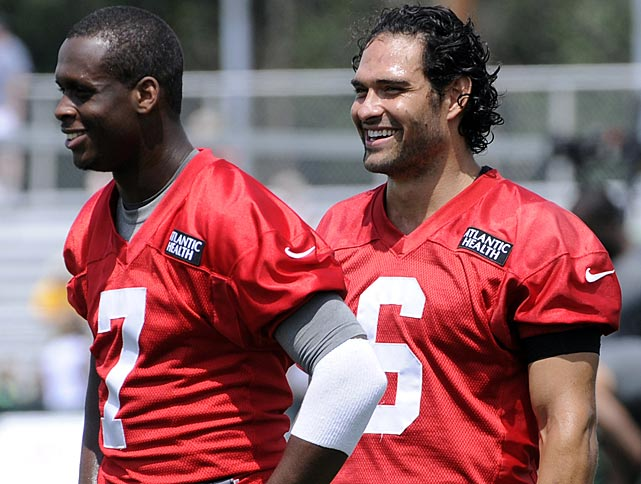 New York Jets quarterbacks Geno Smith (7) and Mark Sanchez (6) smile during training camp in Cortland, N.Y.