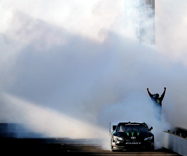 Kyle Busch celebrates with a burnout after winning the Indiana 250 at Indianapolis Motor Speedway on July 27.