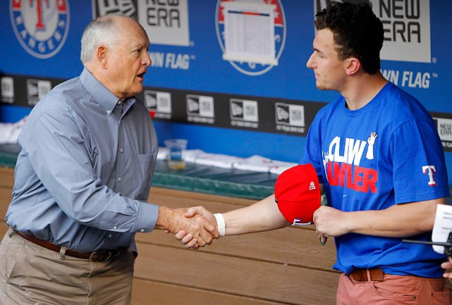 Pitching great and Rangers CEO Nolan Ryan shakes hands with Manziel. The young quarterback was in Arlington to throw the first pitch before the game on April 7.