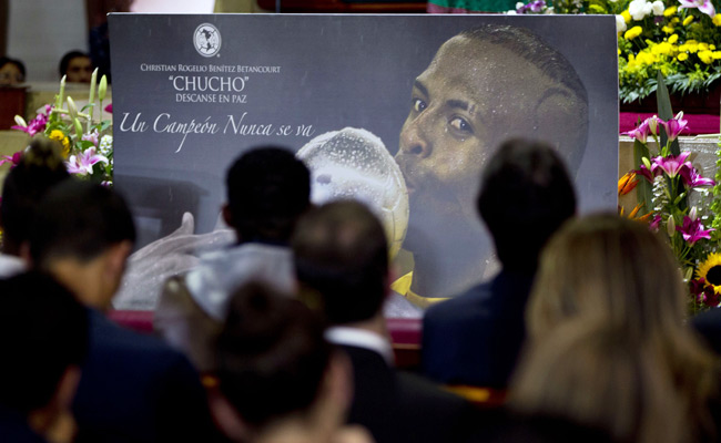 Mourners attend a Mass in honor of Christian Benitez in Mexico City on Monday.