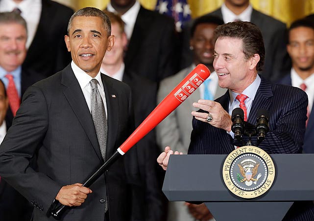 Louisville's coach presents the POTUS with a little something that should come in handy when dealing with a recalcitrant congress...