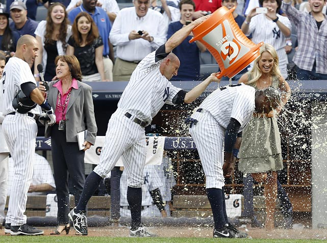 Alfonso Soriano is doused by teammate Brett Gardner after Soriano drove home the game-winning run in the ninth inning of the Yankees 6-5 victory over the Rays.