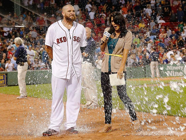Jonny Gomes and sideline reporter Jenny Dell are doused following the Red Sox six-run comeback in the bottom of the ninth. Gomes received a standing ovation when he came off the field in the middle of the ninth after throwing one runner out at third and making a catch while crashing into the Green Monster. He then hit a game-tying RBI single in the Red Sox 8-7 win over the Mariners.