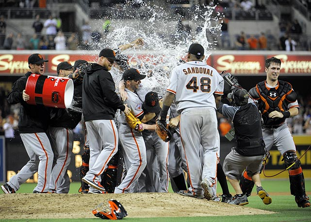 Tim Lincecum and teammates are doused after he pitched a no-hitter in the Giants 9-0 rout of the Padres.