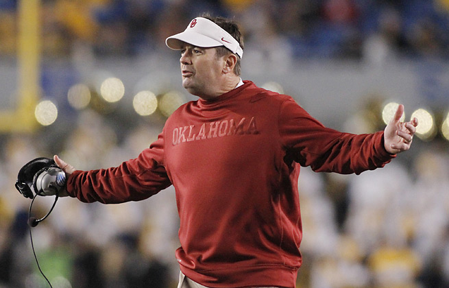 With Landry Jones gone, Bob Stoops has yet to decide who will start at QB for the Sooners this fall.