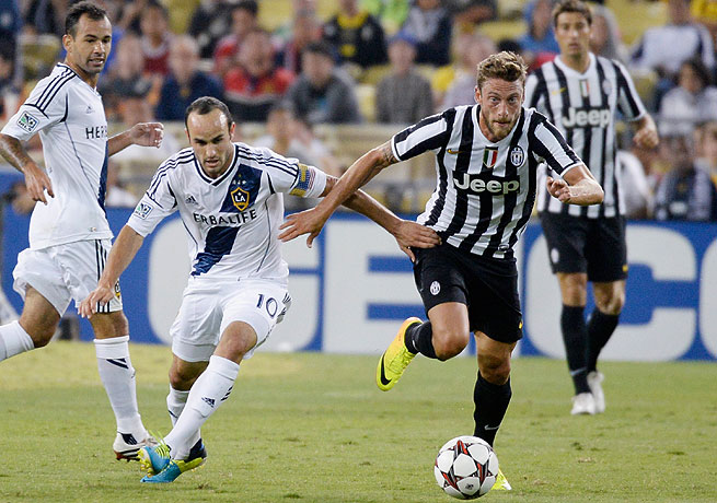 Landon Donovan (left) slotted home in the 60th minute to put the Galaxy ahead against Juventus.