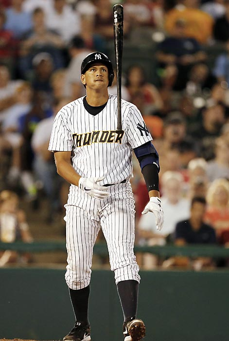 After missing a pitch during a rehab game with Trenton on Saturday, Rodriguez flips his bat.