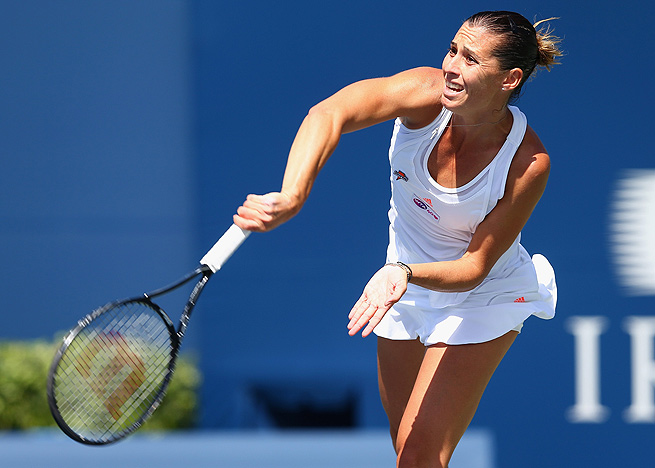 Italy's Flavia Pennetta defeated Urszula Radwanska 6-3, 3-6, 6-2 to move into the second round.